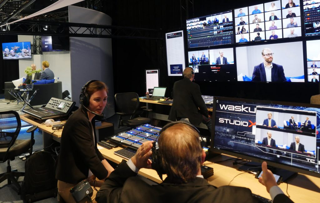 Waskul.TV Production Manager Katherine Waskul confers with Mark Tullos in the StudioXperience Broadcast Control Center in at the 2017 NAB Show