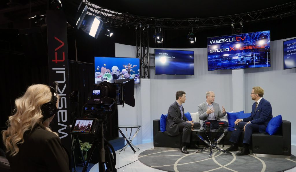 Waskul.TV production team member Brooke McKivergan checks image quality as HP's Josh Peterson and AMD's Ogi Brkic join Steve Waskul on stage in StudioXperience at the 2017 NAB Show
