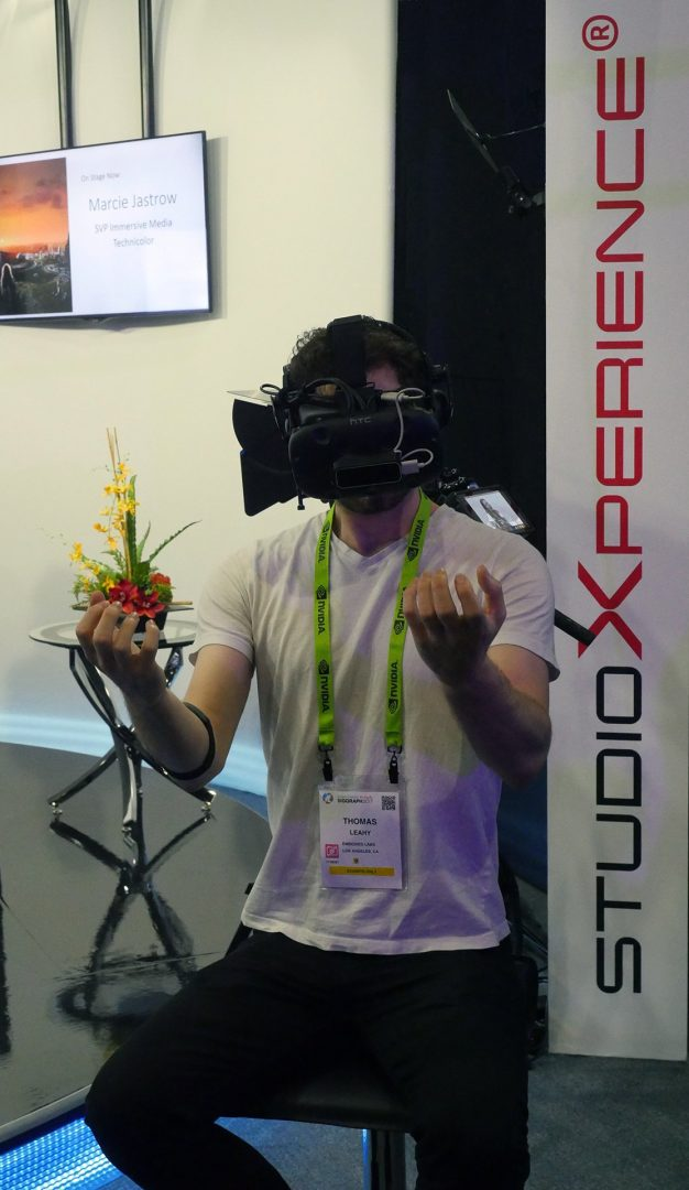 SIGGRAPH 2017 attendee Thomas Leahy tries the immersive VR pain relief demo created by Firsthand Technology in StudioXperience.