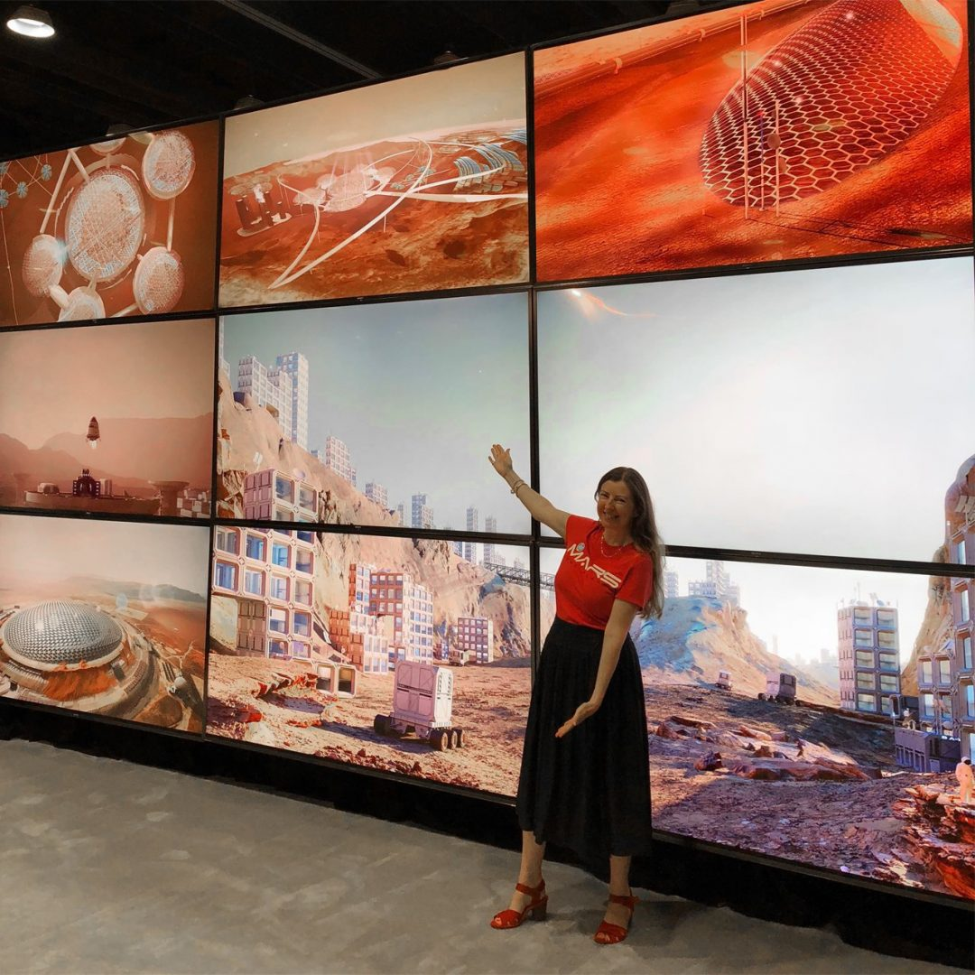 HP Global Segment Manager, Media & Entertainment Barbara Marshall shows off some of the HP Mars Home Planet renders on the StudioXperience 12K video wall at SIGGRAPH 2018
